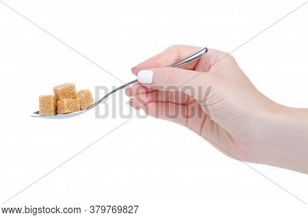 Hand Holding Teaspoon With Cane Brown Sugar Cubes On White Background Isolation
