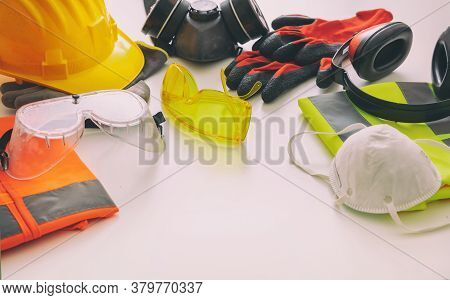 Work Safety Protection Equipment Background. Industrial Protective Gear On White