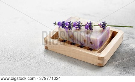 Natural Homemade Lavender Soap With Lavender Flowers On Wooden Soap Dish On Marble Stone Table Backg