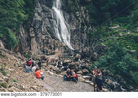 Gwynedd, Wales, Uk - 30 July, 2020: Crowd Of People At Aber Falls Or In Welsh Rhaeadr Fawr . This Wa