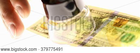 Hand With Magnifying Glass And Dollars, Money Check. Verify Authenticity Money. Verification Authent