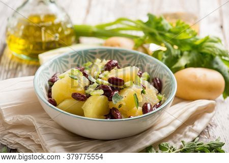 potatoes salad with red beans oregano and celery