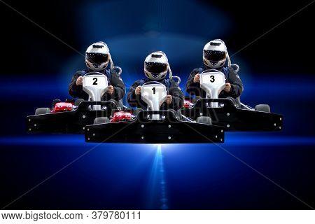 Three Riders Go Kart Speed Rive Indoor Racing On A Blue Background. Go Kart Indoor, Cart Racing Fast