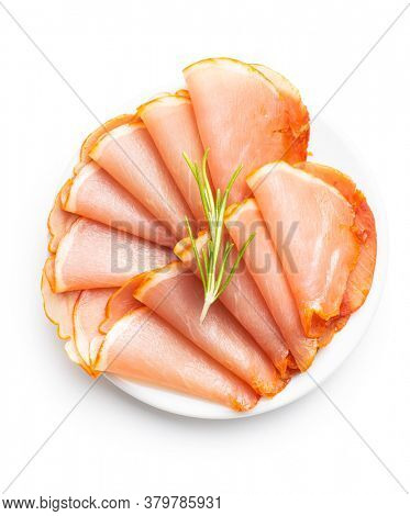 Dried spanish ham on plate. Lomo embuchado isolated on white background.
