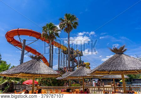 Antibes, France 26.07.2020 Water Park, Slides Near The Pool, Summer Holidays. Bright Colored Water S