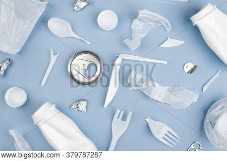 White Single Use Plastic On Blue Background. Environmental, Pollution Concept.