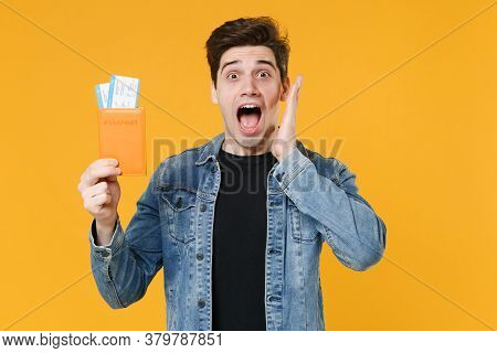 Shocked Young Man Guy In Casual Denim Jacket Isolated On Yellow Background. Passenger Traveling Abro