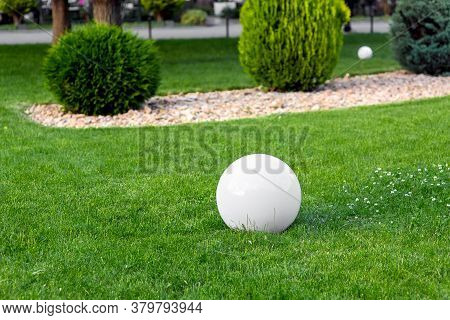 Backyard Light Garden With Electric Ground Lantern With Sphere Diffuser Lamp In Lawn In Outdoor Park
