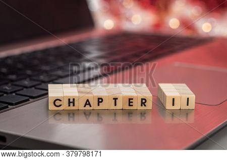 Chapter 11 Letter Blocks Business Finance Concept On Laptop Keyboard