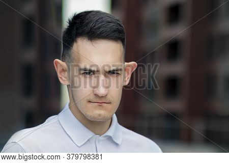 Portrait Of Handsome Frustrated Serious Young Man, Funny Cool Upset Guy With Big Ears Looking At Cam