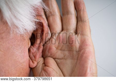 Audiology Ear Problem. Old Man Trying To Hear