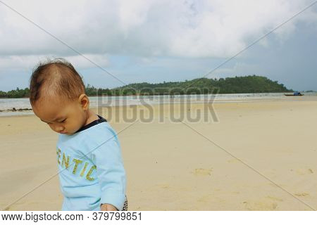 A Beautiful Cute Indonesian Baby On The Beach