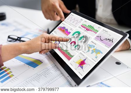 Financial Analyst Using Convertible Laptop Screen With Graphs