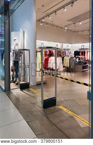 A Narrow Aisle Left In A Clothing Store To Control The Number Of Visitors During The Covid19 Outbrea
