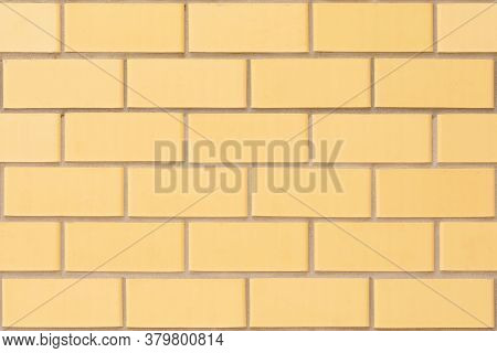 The Natural Background Of The Wall Is Made Of Yellow Finishing Bricks. Smooth Brickwork Of A Modern