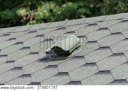 Close-up Of Ventilation In The Sloped Roof Of House. Construction Of Houses. Attic Ventilation