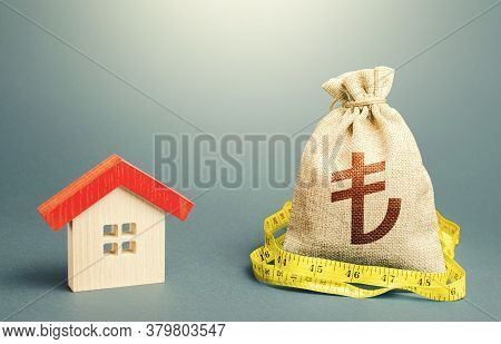 House And A Turkish Lira Money Bag. Calculation Of Expenses For Purchase, Construction And Repair. B