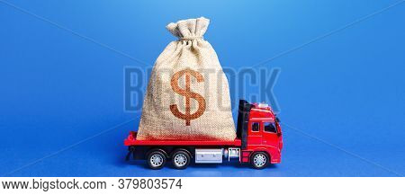 The Truck Is Carrying A Huge Dollar Money Bag. Great Investment. Attracting Large Funds To The Econo