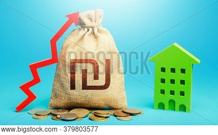 Israeli Shekel Money Bag With Red Up Arrow And Residential Building. Recovery And Growth In Property