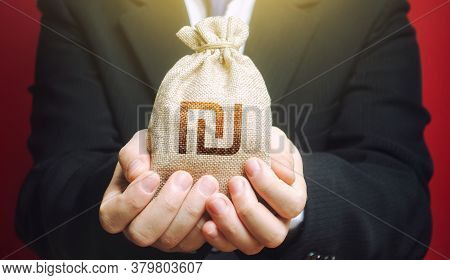 Man Holds Out A Israeli Shekel Money Bag. Budget Management, Collect Taxes. Bank Issuance Of Credit