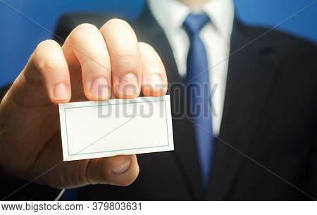 Businessman Introduces Himself With A Business Card. Presentation, Hands Over Contacts To Client. Ag