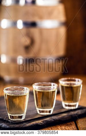 Small Dose Glasses, High Quality Distilled Alcohol. Brazilian Cachaça (called Pinga), Dripping, With