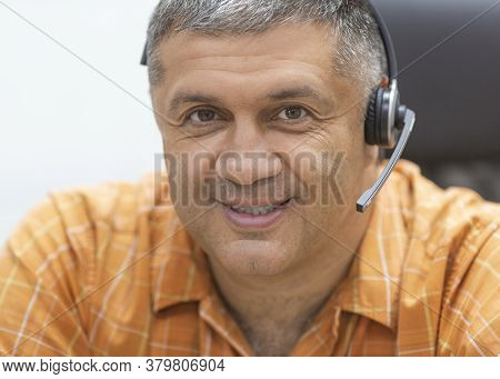 Online Working Concept. Smiley Man With Headset Looking At Camera. Close Up Portrait.