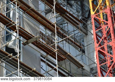 Scaffolding Pipes And Catwalk Platform Set Up At Building Facade Construction Site