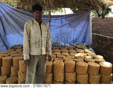 Narsinghpur, Madhya Pradesh/india : November 16, 2019 - A Man Showing Jaggery Stock Made By Sugarcan