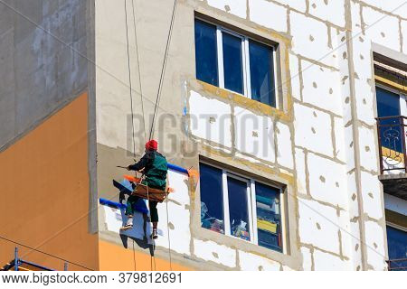 Styrofoam Insulation Of High-rise Building. Rope Access Working. Concept Of Industrial Alpinism