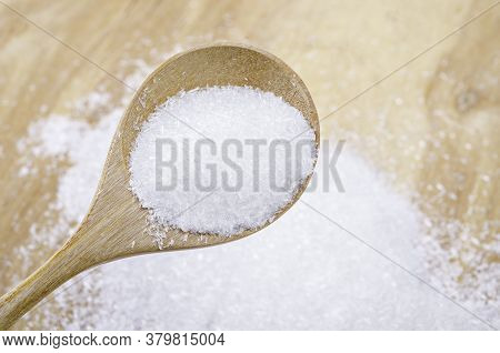 Monosodium Glutamate (msg) In Wooden Spoon, A Flavor Enhancer In Many Asian Food