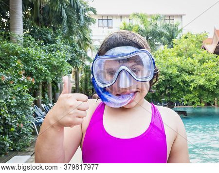 Beach Vacation Fun Girl Wearing A Snorkel Scuba Mask Making A Goofy Face While Swimming In Ocean Wat