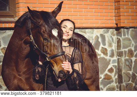 Rider Elegant Woman Talking To Her Horse. Portrait Of Riding Horse With Woman . Equestrian Horse Wit