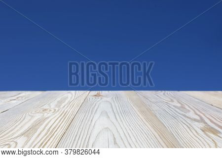 Clear Blue Sky Background With Top Table For Display Or Montage Your Products