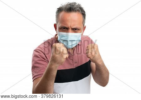 White Man Showing Fists Gesture With Angry Look As Covid19 Angry Concept Wearing Surgical Mask Isola