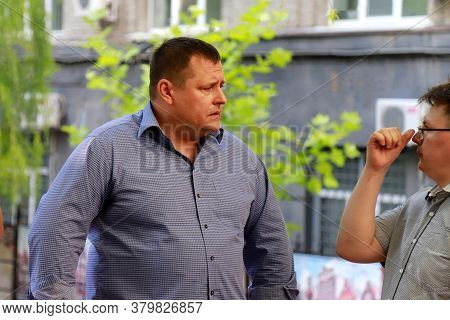 Dnipro City, Ukraine. Well-known Mayor Boris Filatov Talks To A City Resident On The Street. Filatov
