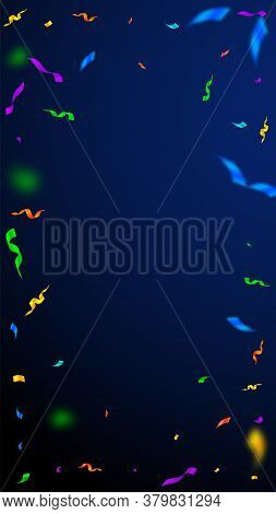 Streamers And Confetti. Colorful Streamers Tinsel And Foil Ribbons. Confetti Vignette On Dark Blue B