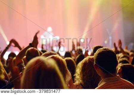 People In A Concert Church Raising Hands Singing Along Worshipping Dancing Enyoying The Music While