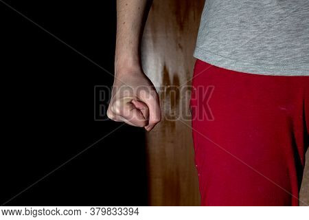 Domestic Violence.  Female Hand Clenched Into A Fist. Aggressive Person. Violence Of One Family Memb