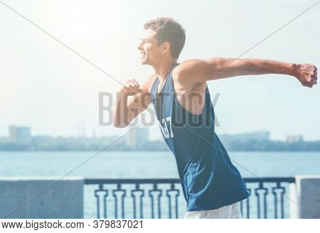 Muscular Active Athlete Young Male Dressed Sleeveless Shirt Running By The River Promenade On Sunny