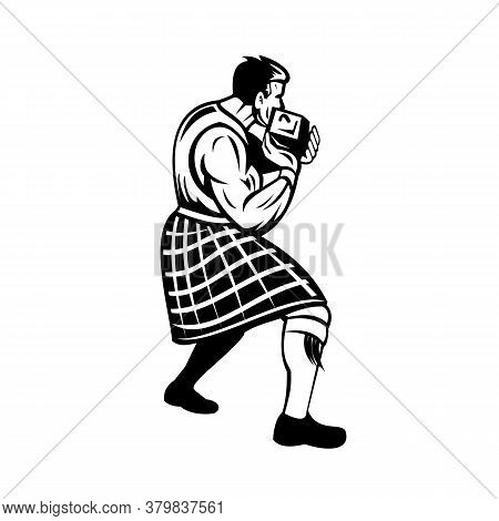 Retro Black And White Style Illustration Of A Scot Or Highlander Putting The Heavy Stone Or Stone Pu