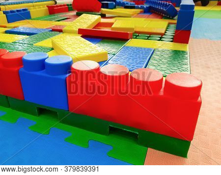 Colorful Plastic Large Blocks From A Kids Designer. Children Builded A Wall In A Playground With A C