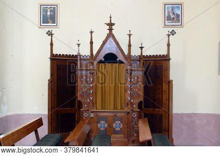 HERCEGOVAC, CROATIA - OCTOBER 01, 2011: Confessionals in the parish church of St. Stephen the King in Hercegovac, Croatia