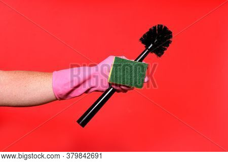 Hand With Glove, Brush And Pad On Red Background