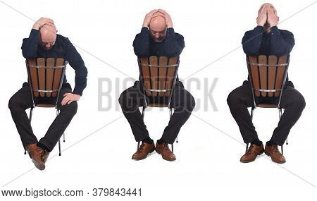 Thoughtful Man Sitting On A Chair On White Background