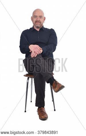A Bald Man Sitting On White Background