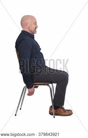 Portrait Of A Man Sitting On A Chair In White Background,
