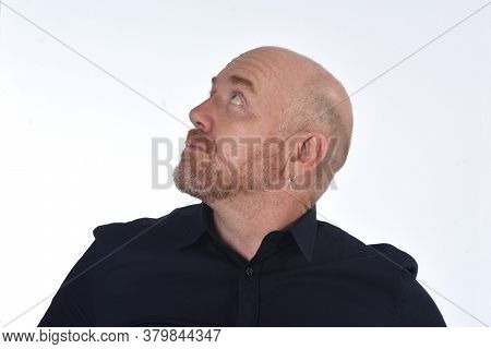 Portrait Of A Bald Man Looking Up On White