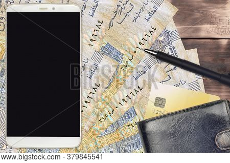 25 Egyptian Piastres Bills And Smartphone With Purse And Credit Card. E-payments Or E-commerce Conce
