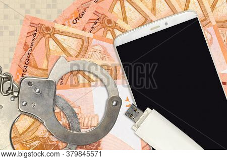 5 Belorussian Rubles Bills And Smartphone With Police Handcuffs. Concept Of Hackers Phishing Attacks